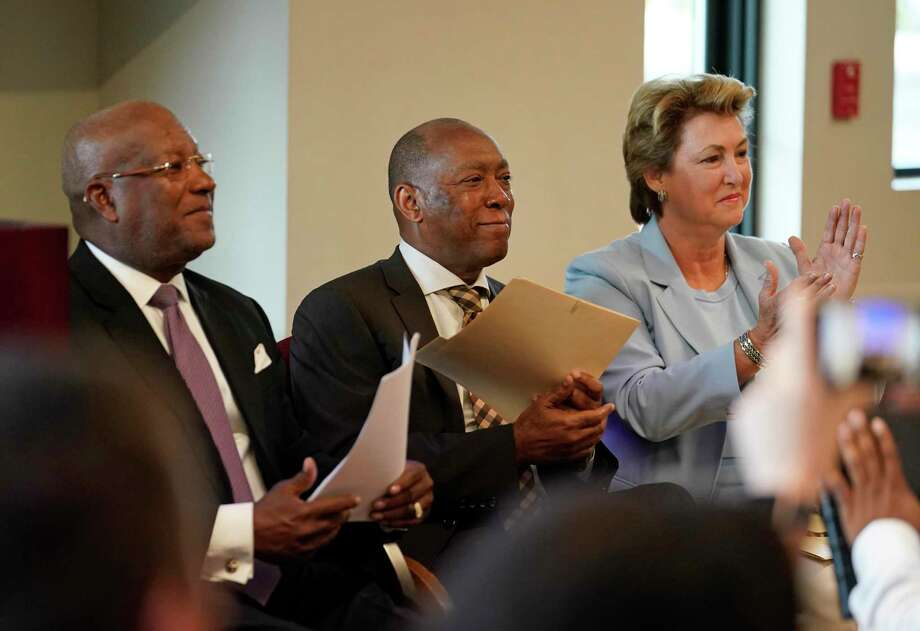 Harvey Clemons Jr., pastor of Pleasant Hill Ministries, left, Houston Mayor Sylvester Turner, and Harris County District Attorney Kim Ogg, are shown during a press conference on Monday, July 29, 2019, about the Center for Urban Transformation's Juvenile Justice Diversion Program in Fifth Ward in Houston. The CUT announced its first program, in partnership with the Harris County District Attorney's Office, to help keep youth out of the criminal justice system. The program will work with 12- to 16-year-olds with non-violent offenses and offer mentorship, volunteer work and community-based support services. The CUT is a new organization that represents a collaboration of the Fifth Ward Community Redevelopment Corporation, Pleasant Hill Ministries, Berg & Androphy law firm, Houston Habitat for Humanity, and Legacy Community Health. Photo: Melissa Phillip, Houston Chronicle / Staff Photographer / © 2019 Houston Chronicle
