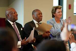 Harvey Clemons Jr., pastor of Pleasant Hill Ministries, left, Houston Mayor Sylvester Turner, and Harris County District Attorney Kim Ogg, are shown during a press conference on Monday, July 29, 2019, about the Center for Urban Transformation's Juvenile Justice Diversion Program in Fifth Ward in Houston. The CUT announced its first program, in partnership with the Harris County District Attorney's Office, to help keep youth out of the criminal justice system. The program will work with 12- to 16-year-olds with non-violent offenses and offer mentorship, volunteer work and community-based support services. The CUT is a new organization that represents a collaboration of the Fifth Ward Community Redevelopment Corporation, Pleasant Hill Ministries, Berg & Androphy law firm, Houston Habitat for Humanity, and Legacy Community Health.