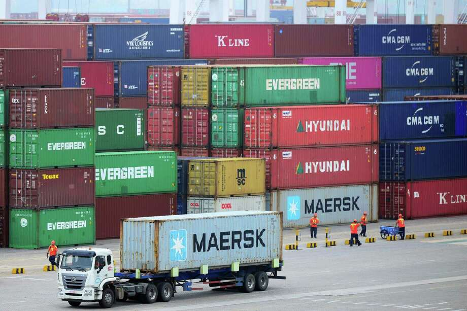 This photo taken on July 11, 2019 shows a truck in front of stacked containers at the container port in Qingdao, China's eastern Shandong province. - China's economy grew at its slowest rate in nearly three decades in the second quarter, according to an AFP survey of analysts, hit by the US-China trade war and weakening global demand. (Photo by - / AFP) / China OUT-/AFP/Getty Images Photo: - / Getty Images / AFP or licensors