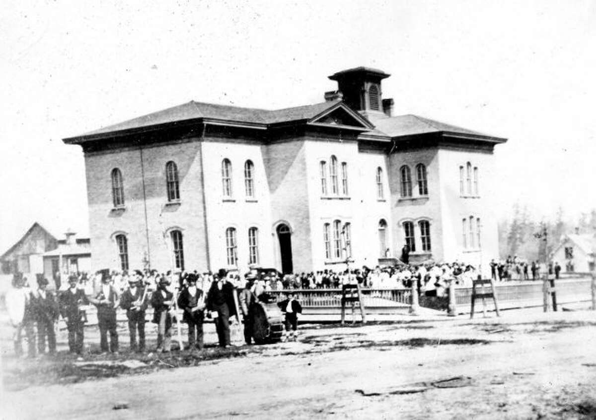 Manistee's first brick school located on the block of Second, Oak, and First streets. The building burned in May 1886.
