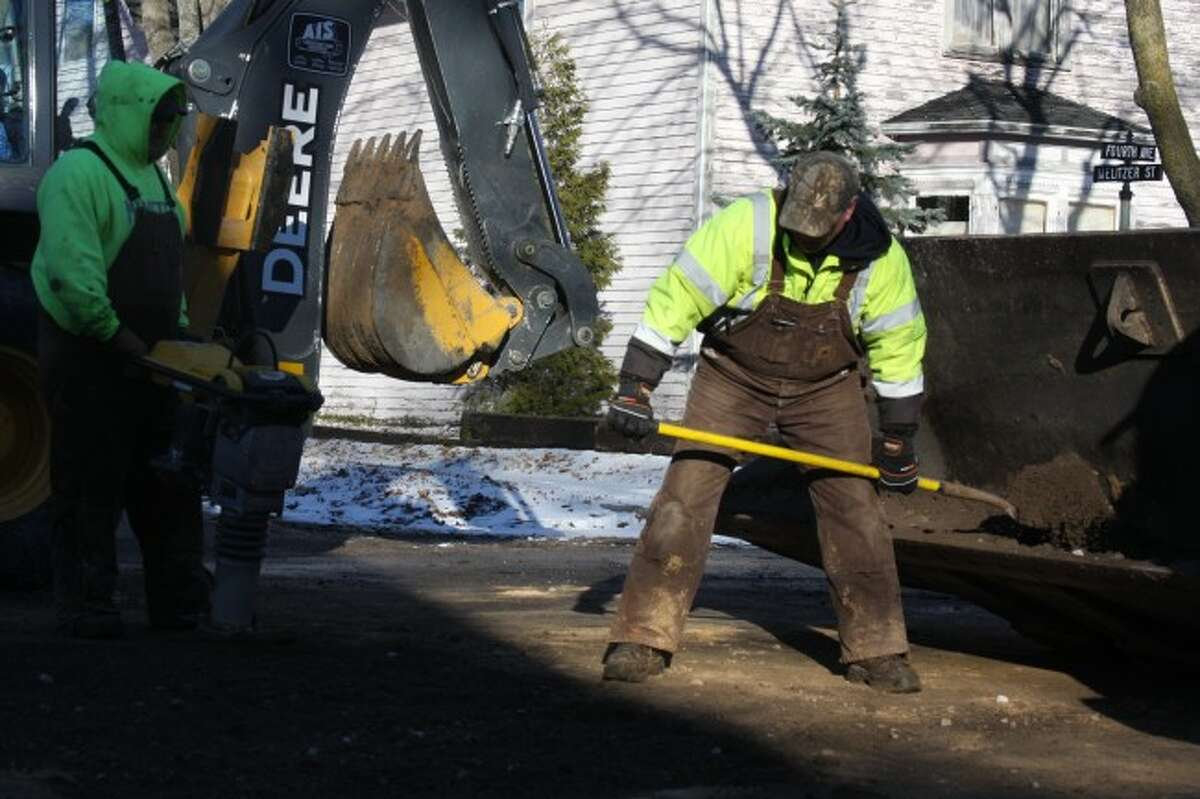 Photo by Sean Bradley / News AdvocateEmployees of the City of Manistee Department of Public Works finished repairing a water main Friday, which had broken Thursday on Third Avenue east of Monroe Street in Manistee.