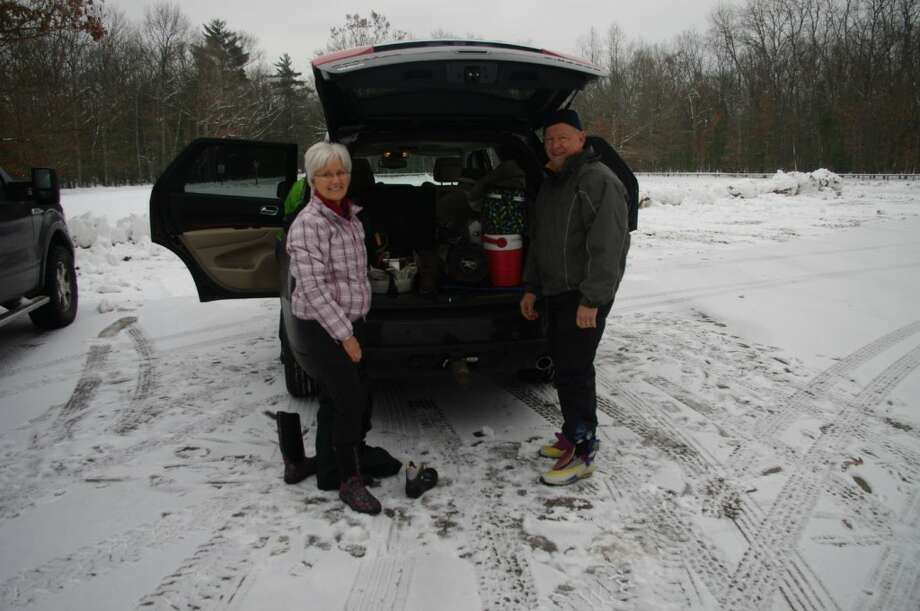 Joyce Helder of Big Rapids prepares to head out on the trails with her brother Dennis Kirkby of Boyne City. (Dave Yarnell/News Advocate)