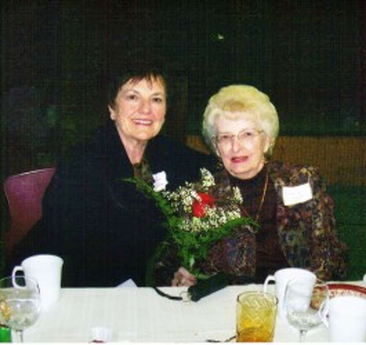 Nancy Lyon, right, with friend Marilyn Galer, attends the induction ceremony for Delta Kappa Gamma, a sorority for women educators. (Courtesy Photo)