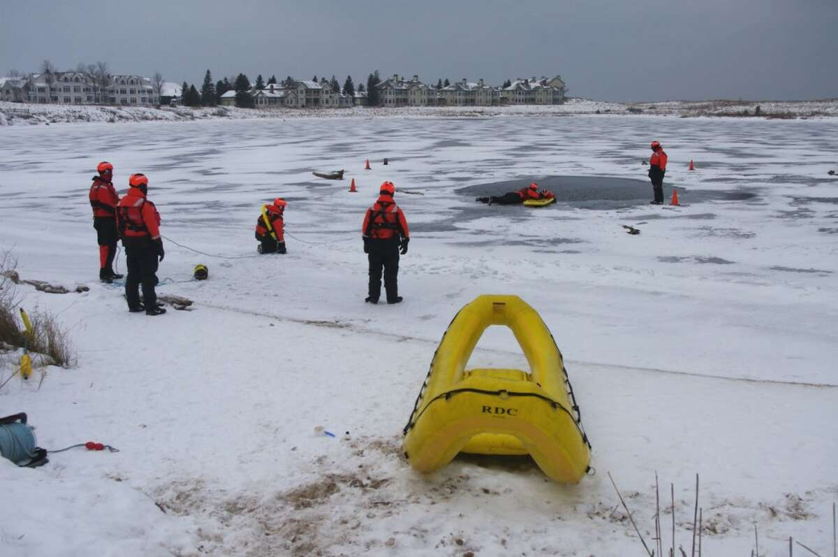 Personnel from Coast Guard Station Manistee conducted ice rescue training on Man Made Lake in Manistee on Thursday morning. (Dave Yarnell/News Advocate)
