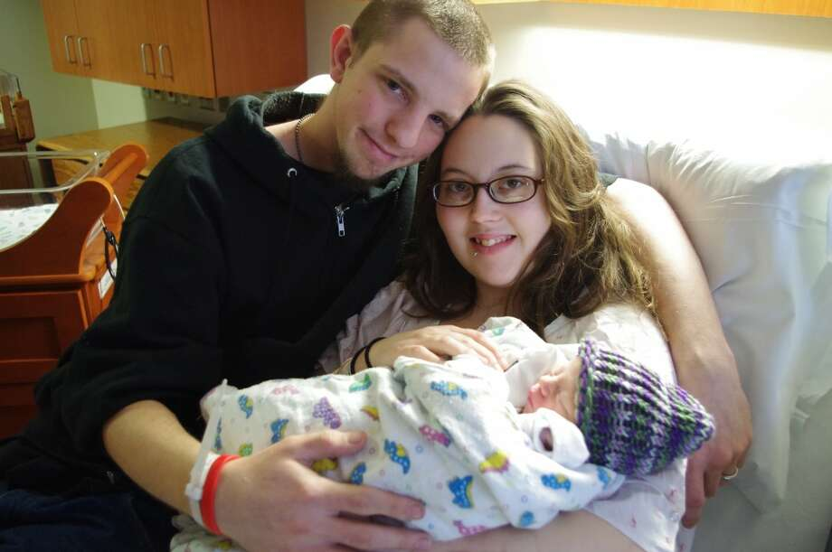 Lakota Tyler and Amber Evans hold Cory James Charles Tyler, the first baby born at West Shore Medical Center in 2013. Cory arrived at 11:43 a.m. on Thursday, Jan. 3. (Dave Yarnell/News Advocate)