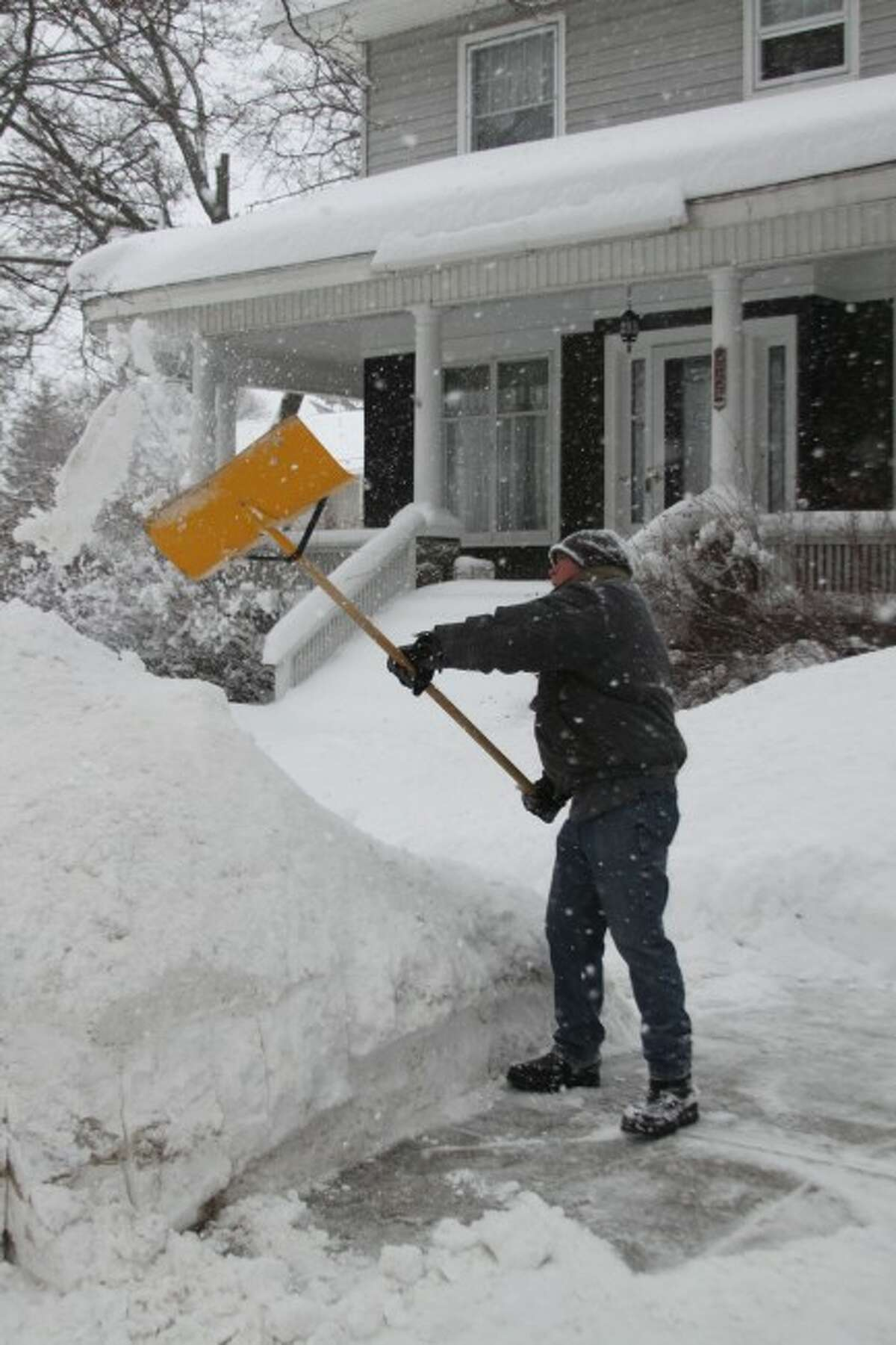 People should use extreme care when shoveling snow to aovid injury.