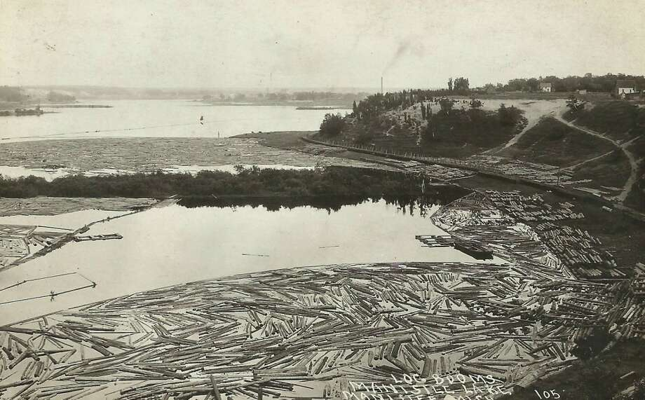 Logs on Manistee Lake in the late 1800s or very early 1900s. (Courtesy Photo/Dale Picardat)