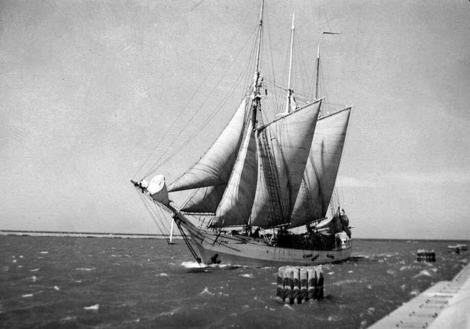 The schooner J.T. Wing returns to the Manistee Harbor.