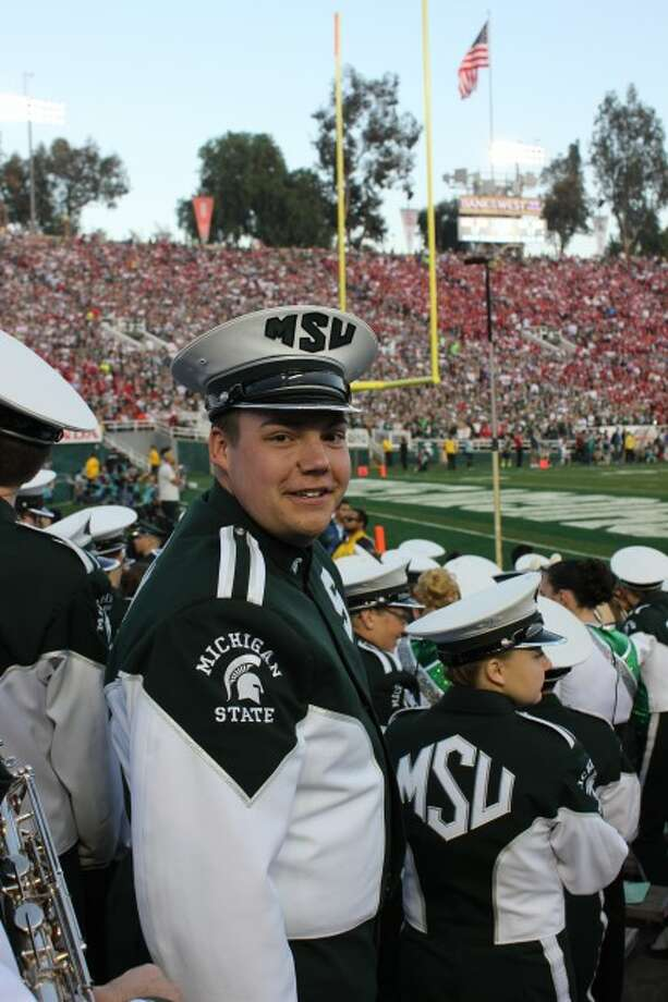 Roger Mullet looks over his shoulder at his sister, Sam, who captured this image of him at the Rose Bowl game. Mullet and fellow Manistee County resident Frank Loomis took part in the Rose Bowl game as part of the Michigan State University Marching Band.