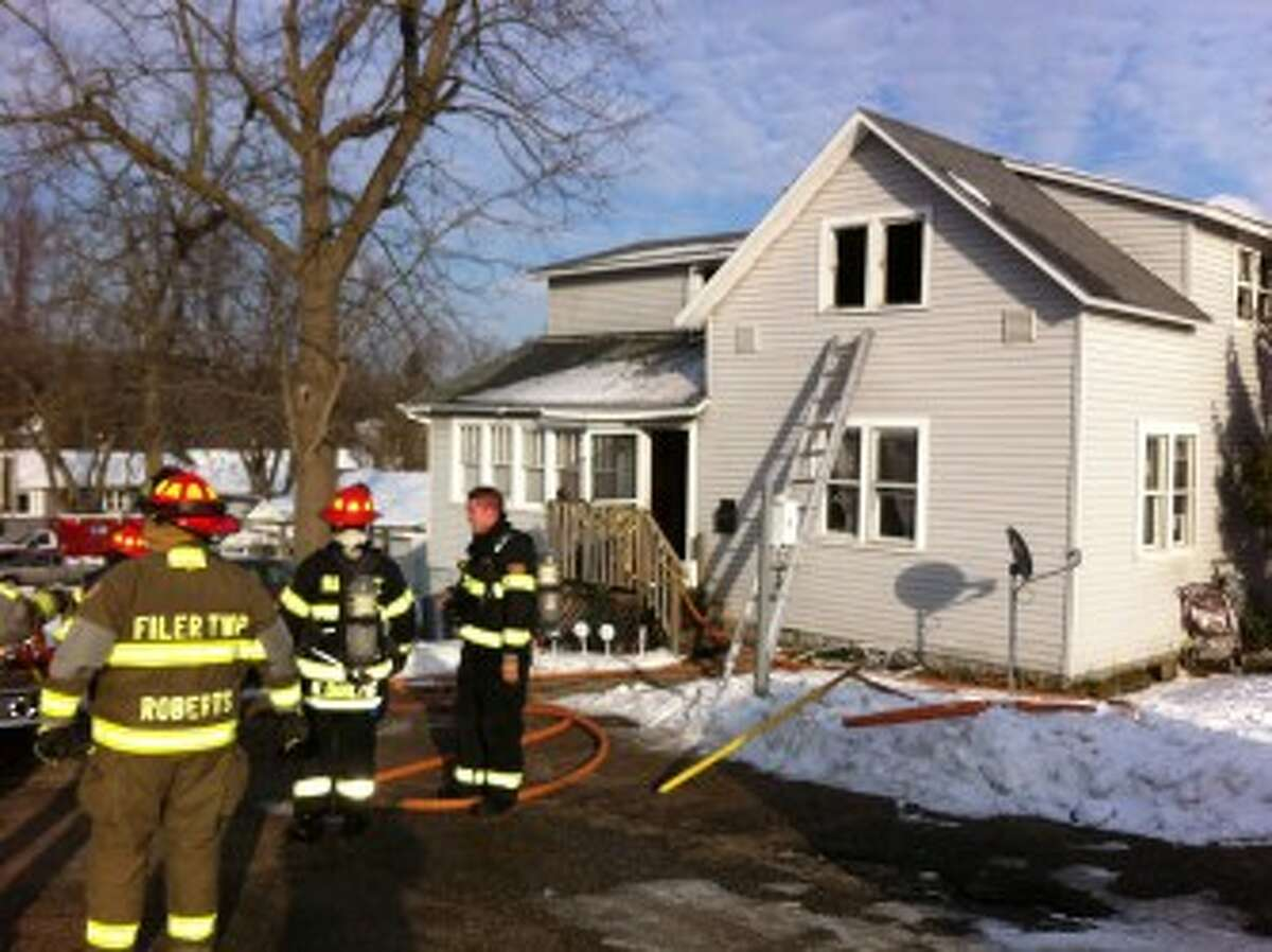 City of Manistee Firefighters at the scene with Filer Township Firefighters.