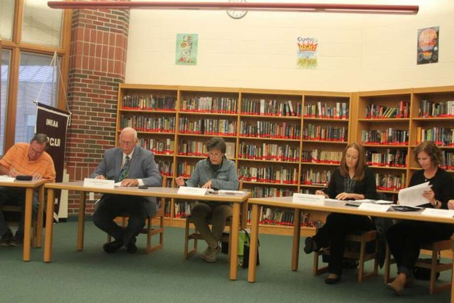 Members of the Onekama Consolidated Schools Board of Education discusses the student count at Monday's board meeting.