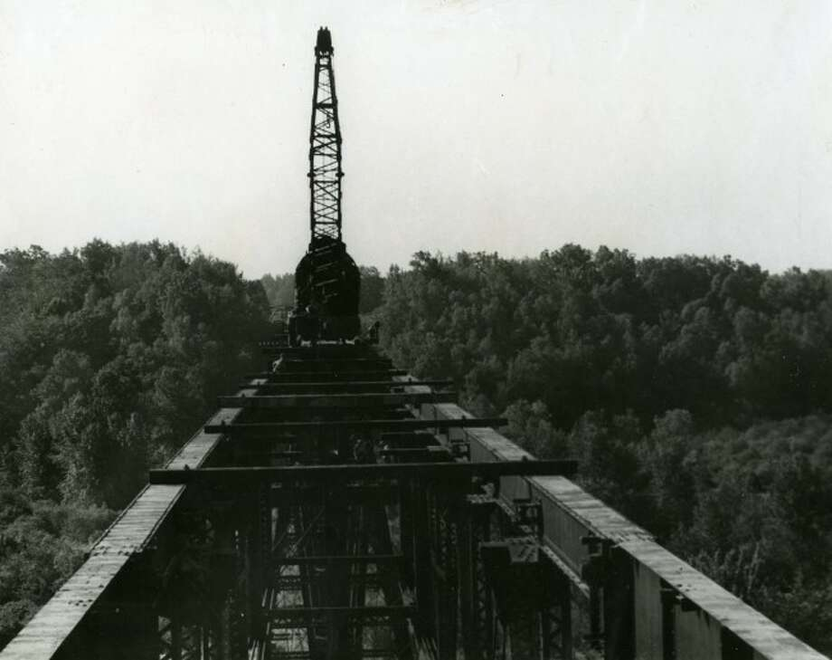 Shown is the dismantling of the High Bridge railroad structure in the 1950s.