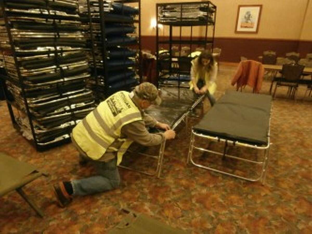 CERT volunteers Dick Lutz and Janette May set up a cot at the shelter. (Courtesy Photo)