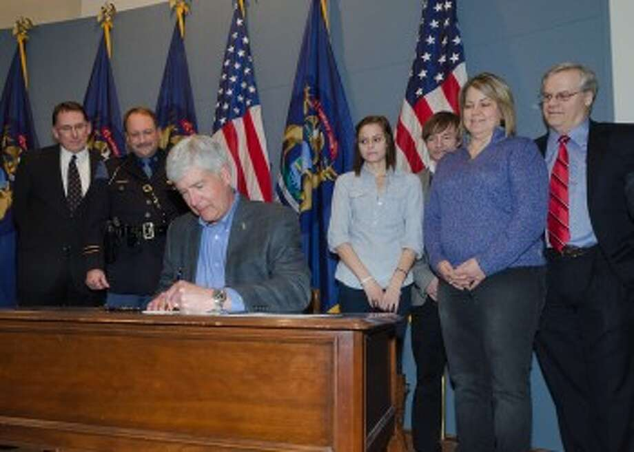 With the Raffaele family on hand, Gov. Rick Snyder today signed Kelsey's Law, named in honor of Kelsey Raffaele, to protect Michigan's teen drivers and all other motorists. (Courtesy Photo)