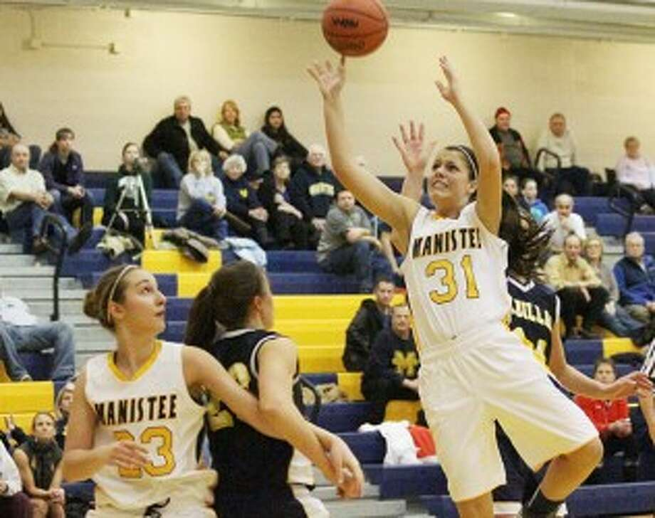 Manistee's Stephanie Smogoleski (31) shoots in front of teammate Audrey Tomaszewski (23) during the second half of Tuesday's game against Cadillac. (Matt Wenzel/News Advocate)