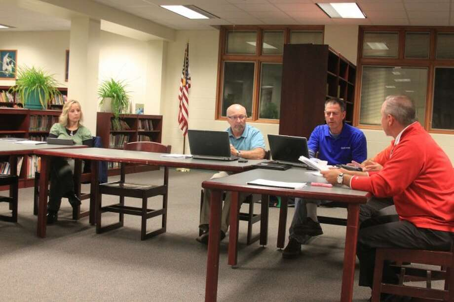 Members of the Bear Lake Board of Education took action this week to re-finance debt bonds at a lower rate.