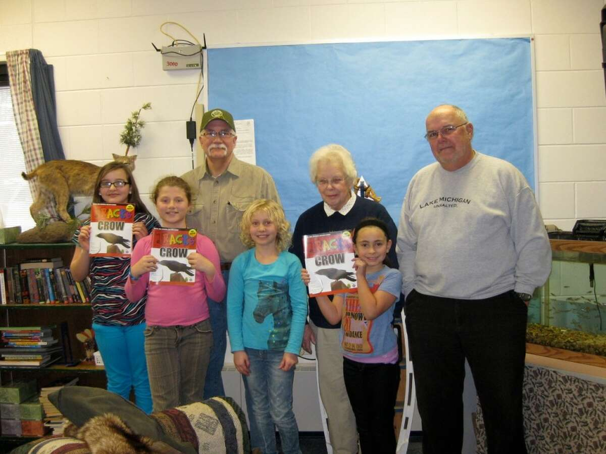 Members of the Spirit of the Woods Conservation Club and the Big Bear Sportsman's Club recently donated the outdoor TRACKS magazines to elementary classrooms. Shown in the back left to right are Terry Vuksanovic (Big Bear Sportsman's Club), Pat Travis (Spirit of the Woods Conservation Club) and Rick Larue (Big Bear Sportsman's Club). Students shown left to right in the front from Jim Wojciechowski's fifth grade class in Brethren (KND) are Grace Adams, Abigail Shackley, Summer Young and Calysta Eckerson. (Courtesy photo)