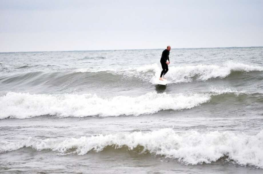 Joe Matulis, of Clare, came to Manistee on Tuesday to surf at Manistee's First Street Beach.