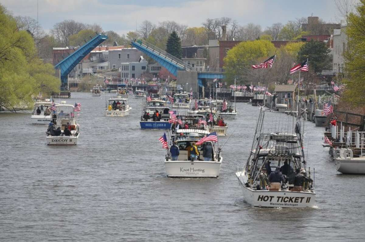 The fifth annual Tight Lines for Troops included 64 charter fishing boats and more than 300 veterans from around Michigan. When the boats returned from a day of fishing, hundreds lined the Manistee River to welcome them back.