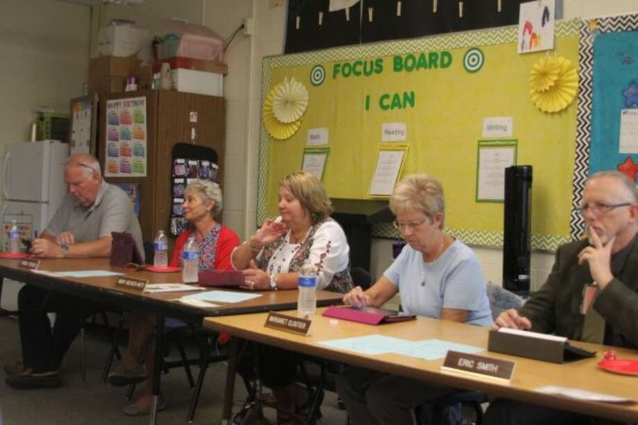 Members of the Manistee Intermediate School District Board of Education listen to reports at Monday's meeting about the start of the new school year. The board met at Bear Lake Schools so they could view the classrooms they rent in that building.