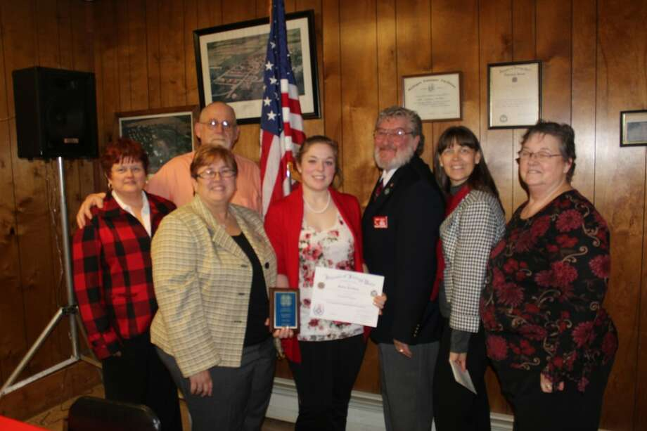 Onekama High School senior Elizabeth Bergren is shown being presented the district Voice of Democracy District award. She will now have her essay move on to the state competition where she has the chance to win some scholarship money. (Courtesy photo)