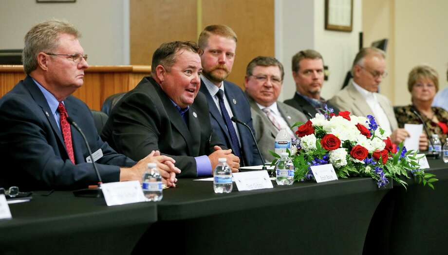 Should Cibolo Mayor Stosh Boyle, second from left, be serving in office. Questions have been raised about a past drug conviction makes him ineligible for higher office. The state's election code needs to be clarified. Photo: Marvin Pfeiffer / / Express-News 2019