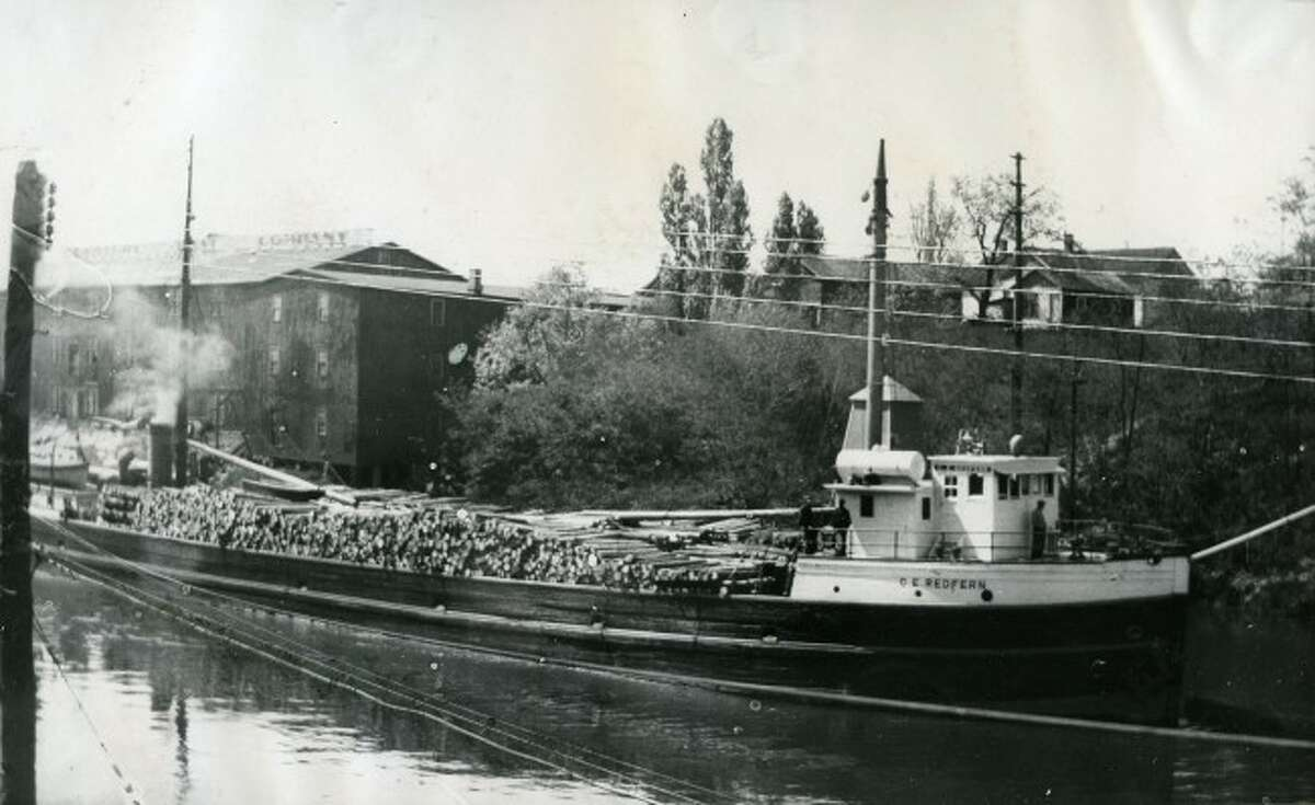 The C.E. Redfern is shown passing through the Manistee River channel in this 1930s photo.