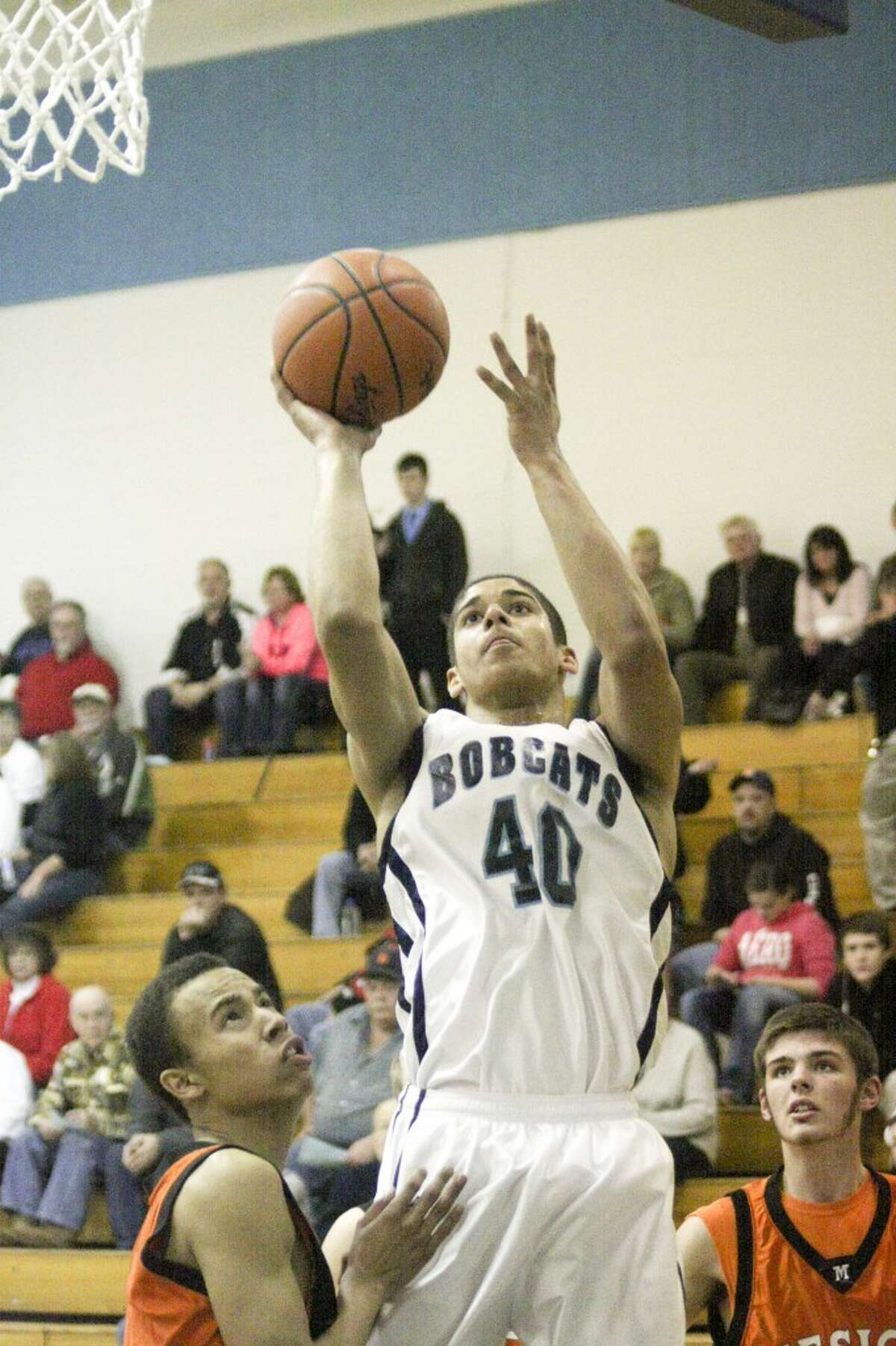Brethren's James Connolly scores during the first half of Tuesday's win against Mesick. (Dylan Savela/News Advocate)