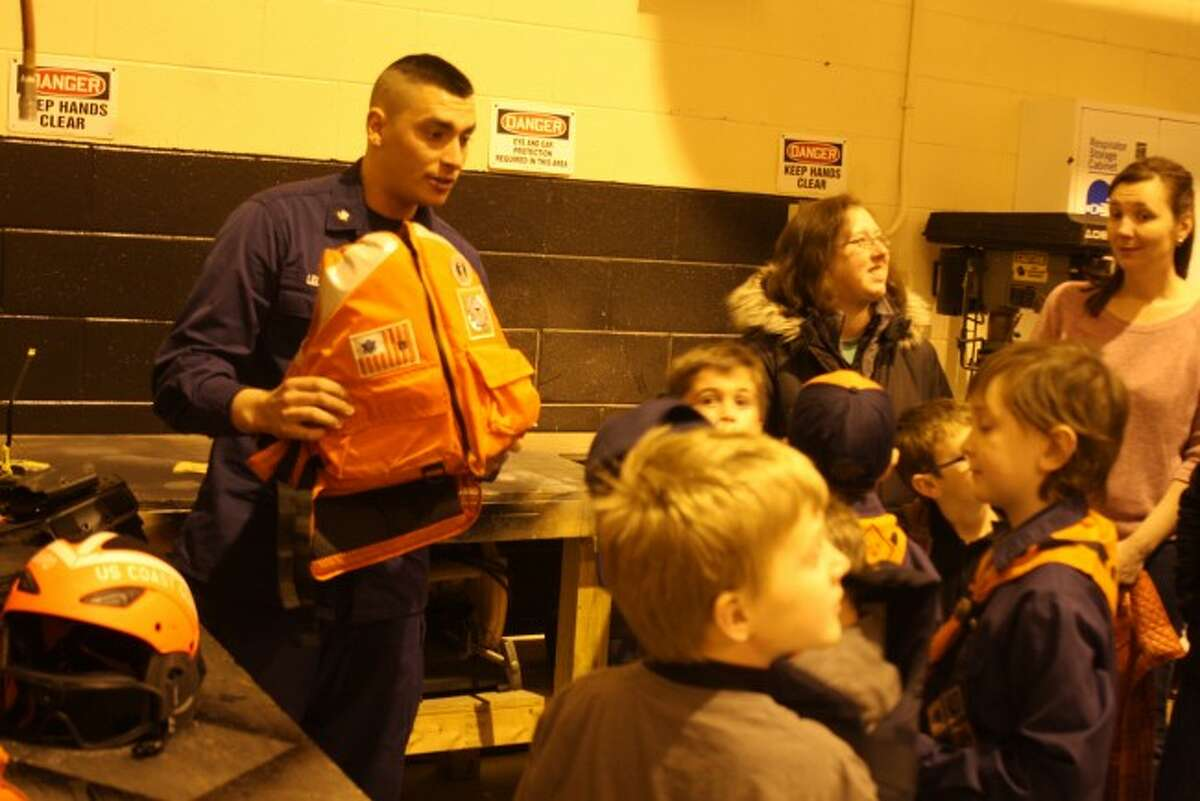 One of the many highlights from the scouts tour of Coast Guard Station Manistee was to try on some of the actual gear the members of the station wear when they go out on a mission.