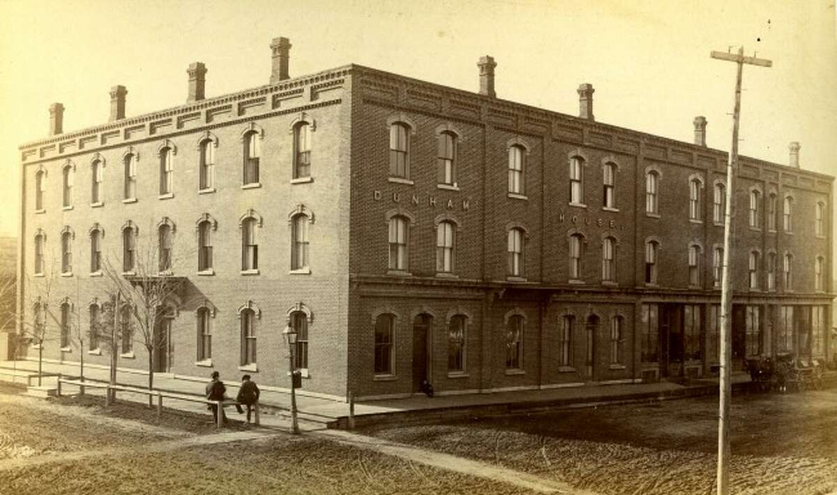 The Dunham House opened in April 1878 and was formerly located on a large lot on the corner of Water and Pine streets.