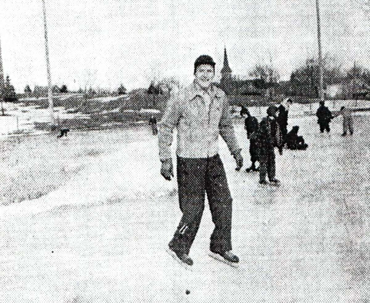 In this photo published in the Manistee News Advocate on Jan. 23, 1947 Coach Glen Hunter is pictured at the Sands Park ice skating rink, donning his skates and brushing up on the skating form which made him a top-flight performer on hockey teams in his native Upper Peninsula. Hunter played on the Newberry city team and on the Wakefield team when he was coaching there. (News Advocate File Photo)