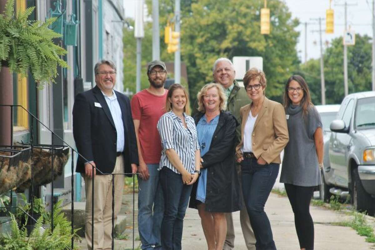 Pictured (from left to right): Marc Miller, Manistee Area Chamber of Commerce economic development director; Corey and Tonya Wagoner, new owners; Virginia Pelton, realtor of Century 21 Boardwalk; Howard and Stacey Vaas, former owners; and Stacie Bytwork, Manistee Area Chamber of Commerce president. (Ashlyn Korienek/News Advocate)
