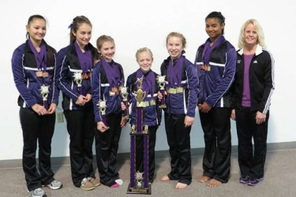 Pictured (from left to right) is the Flipstar team of Krista Stenberg, Miranda Hengy, McKenna Lake, Avah Anthes, Andrea Shoop, Kiela Brooks and head coach Aimee Goff. (Courtesy photo)