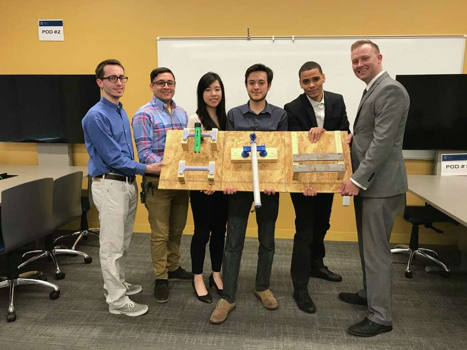 From left are Lone Star College-CyFair's Team Cy-SMIC: Tripp Manzella, David Rubio, Fei Xie, Daniel Laverde, Andres Ledesma and Justin Gallegos. The team is working on a prototype meant to help attach cameras on the International Space Station. Photo: LSC-CyFair
