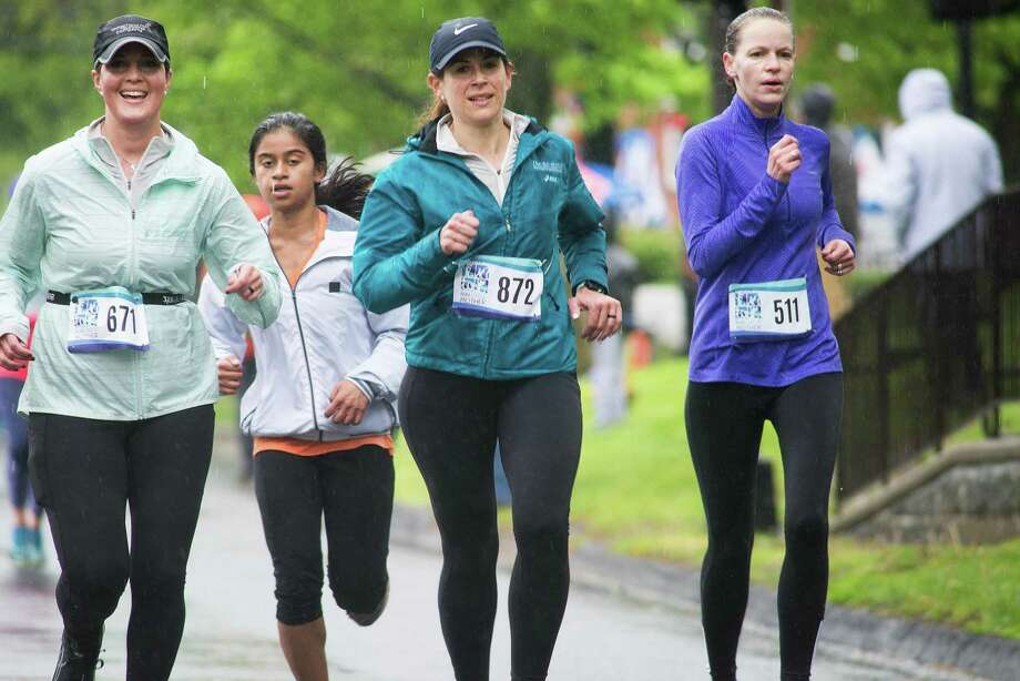 The 12th annual Run Like a Mother 5K took place on a rainy Mother's Day on Sunday, May 23, 2019. The event was originally started by Ridgefield resident Megan Searfoss. Photo: Bryan Haeffele / Hearst Connecticut Media / Ridgefield Press