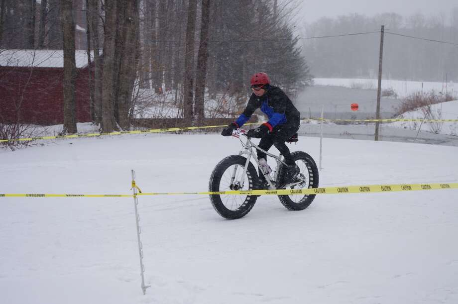 "Taking a bike ride in 11 degree weather might not be an ideal way to spend Sunday afternoon for most of us, but the participants in the ""Fat Chance Fat Tire Bike Race"" held at Crystal Mountain on Sunday didn't seem to mind the cold temperatures. The event was part of the resort's observance of World Snow Day. (Dave Yarnell/News Advocate)"