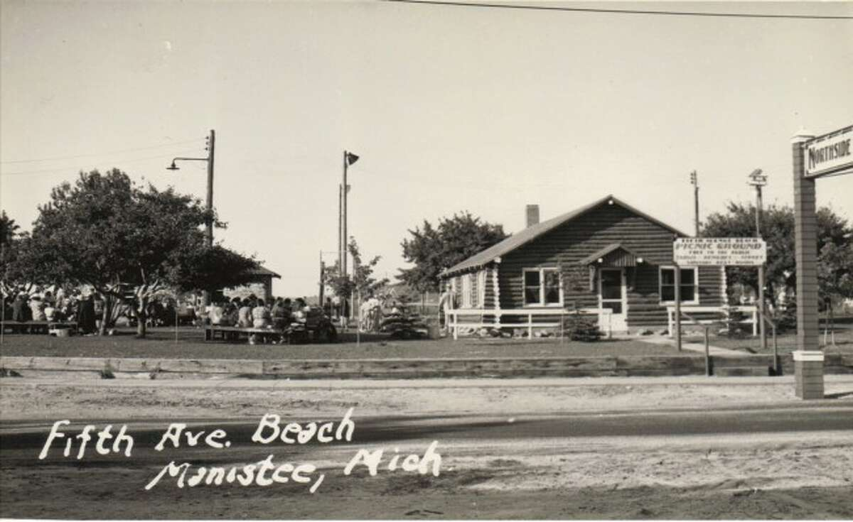 Prior to being torn down by the city, the North Side Improvement Association building at Fifth Avenue Beach was a popular destination for family reunions, birthday parties and other type of summer gatherings. The building is shown in this early 1950s photograph and was located on the vacant lot across from the Station Manistee Coast Guard building.