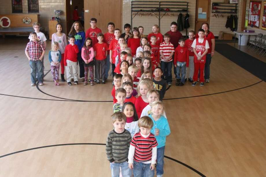 """Trinity Lutheran School students form the letter """"T"""" to honor the week of celebrating Lutheran Schools Week."""