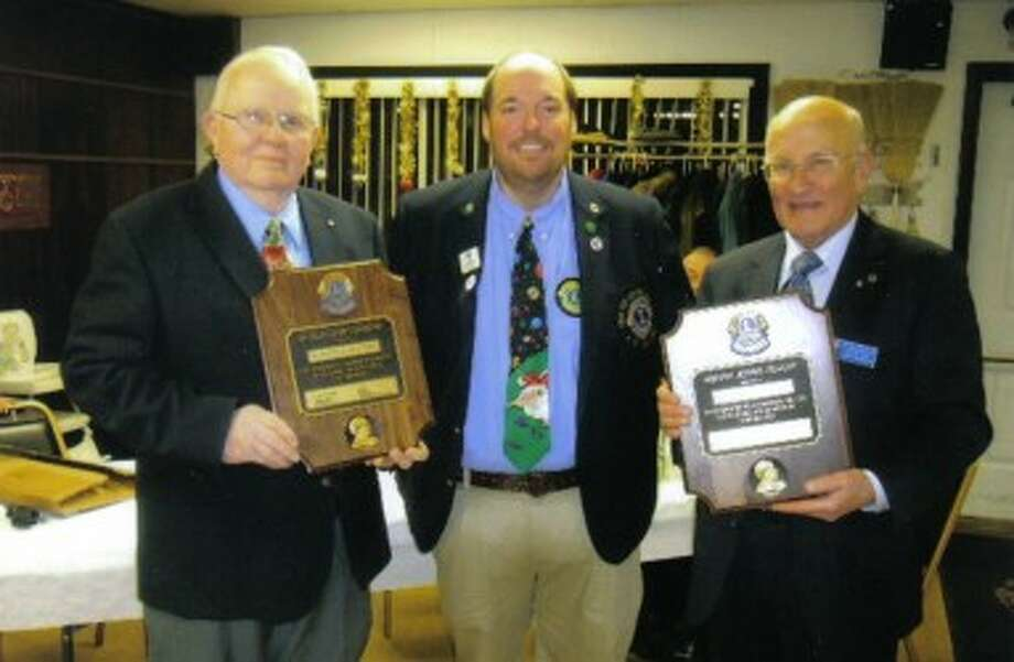 Ken Kuttilla (left) and John Makinen (right), members of the Kaleva Lions Club, recently received Lions International's Melvin Jones Fellowship Award from Tim Anderson (center), Lions International vice district governor. (Courtesy Photo)