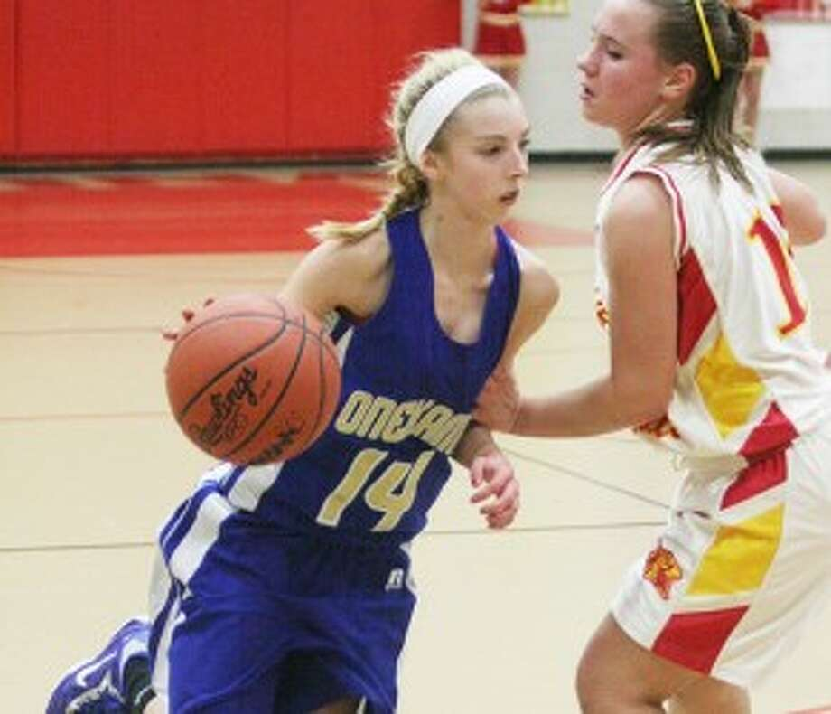 Onekama's Caitlin Zielinski (14) drives to the basket during Thursday's win against MCE. (Dylan Savela/News Advocate)