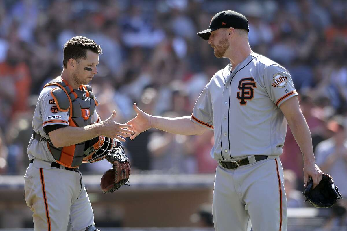 San Francisco Giants' Buster Posey, left, and Will Smith shake hands after defeating the San Diego Padres in a baseball game Sunday, July 28, 2019, in San Diego. (AP Photo/Orlando Ramirez)
