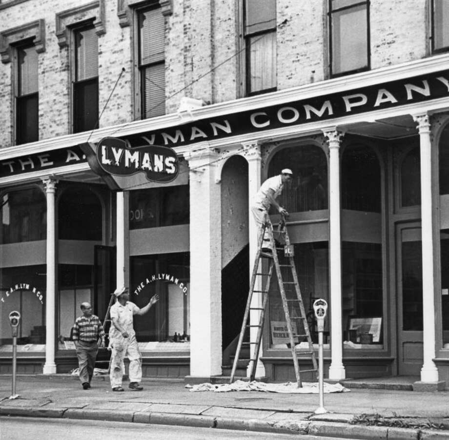 Shown the Lyman Company Building that now houses the Manistee County Historical Museum being painted in 1960.