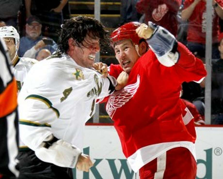 Detroit's Jordin Tootoo (right) fights with the Stars' Brenden Dillon late in the first period at Joe Louis Arena on Tuesday. (Julian H. Gonzalez/Detroit Free Press/MCT)