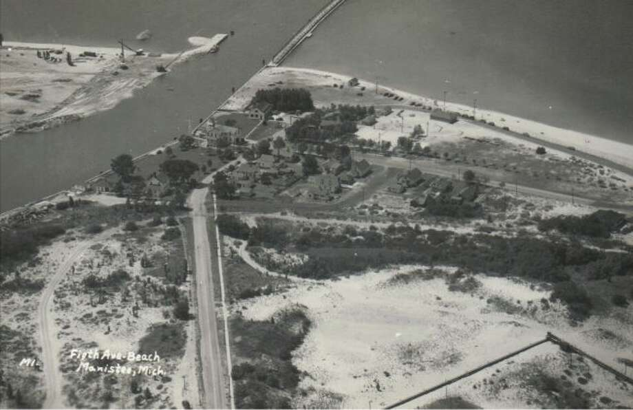 This aerial view of the beach area off the Manistee Harbor in the early 1950s shows a much different appearance than what exists today.