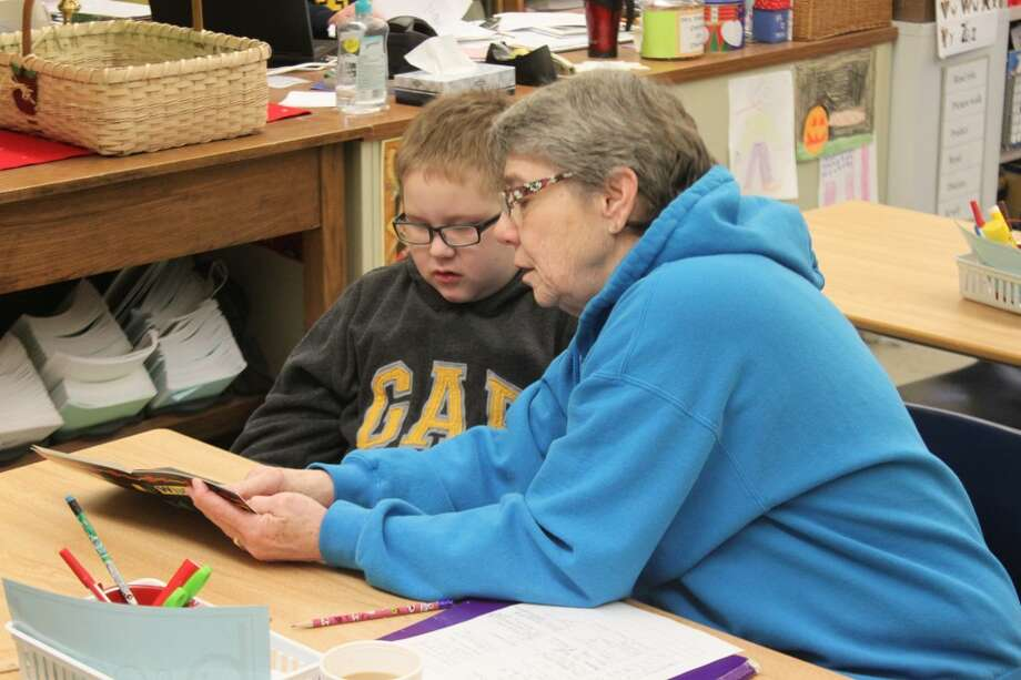 Reading Mentor Kathy Fenstermacher works with Sullivan Ciccip on improving his reading skills. The mentors program at Jefferson Elementary school is designed to assist students in improving their reading skills. (Ken Grabowski/News Advocate)