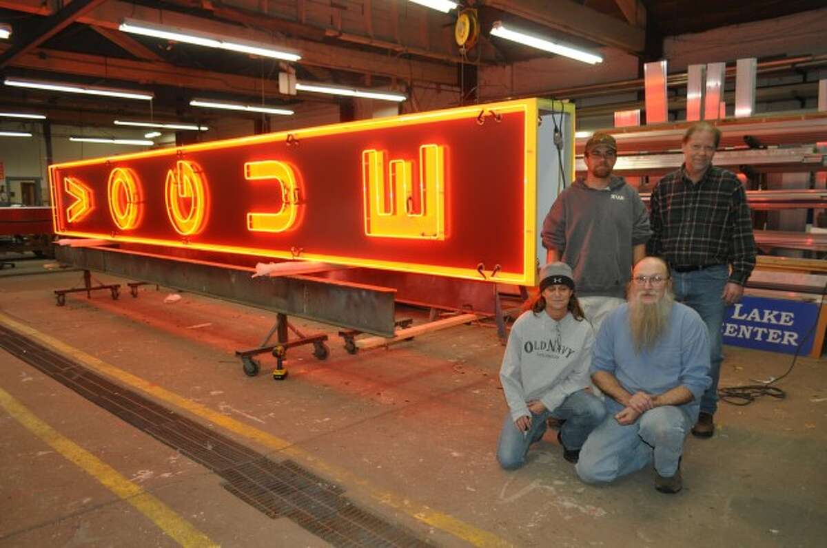 Amor Sign Studio employees Ryan Cramer, Ryon Schramski, Peggy Devereaux and Dale Sheeley helped build the Vogue Theater's new sign, which is slated to be installed on Thursday.