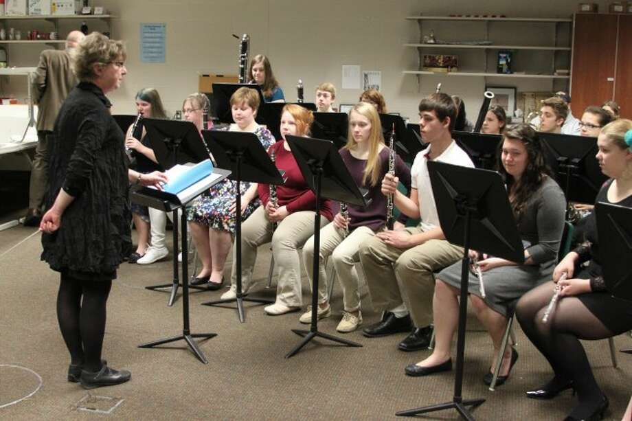 Manistee Area Public Schools director of bands Cynthia Swan-Eagan stands before an ensemble of her students at the recent state finals for solo and ensemble. Swan-Eagan is retiring this year after serving 34 years as band director.