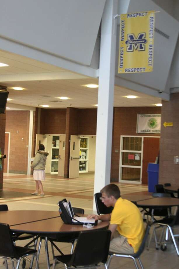 Shown are the new Chippewa Difference banners that are hung in the Manistee Middle/high School Commons area to remind students to show positive behavior to others. (Ken Grabowski/News Advocate)