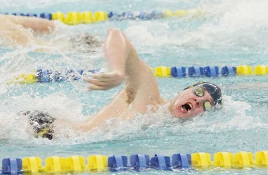 Manistee's John Kutschke swims the third leg of the 400-yard freestyle relay during Thursday's meet against Ludington at the Paine Aquatic Center. (Matt Wenzel/News Advocate)