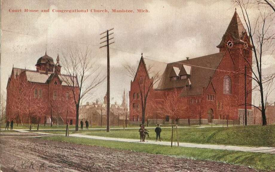 The First Congregational Church and Manistee County Courthouse building are shown in this photograph from the late 1890s.